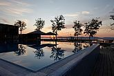 Yachtclub at lake Balaton in Hungary - the outdoor pool by night of the BL Bavaria Yachtclub